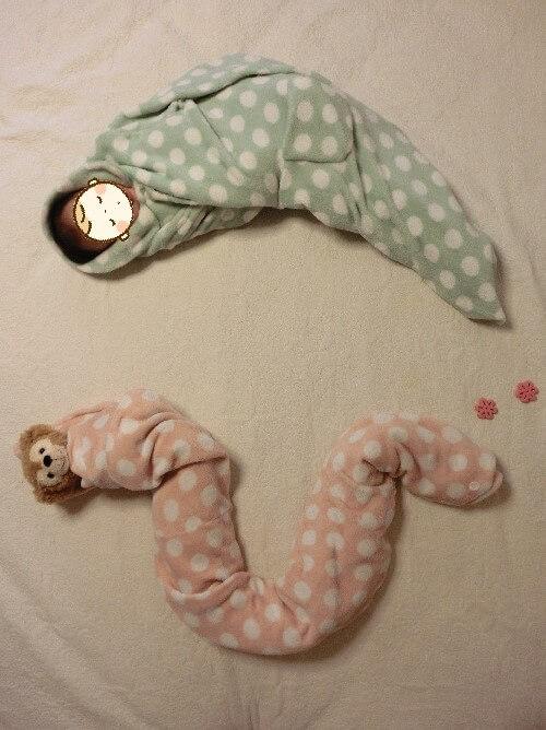 寝相アート へび